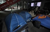 This file photo shows tents and belongings of the anti-capitalist &#39;Occupy&#39; movement in Hong Kong, on the ground level of the HSBC building, pictured in June. Hong Kong court on Monday approved the eviction of the protesters, in a major blow to one of the last outposts of the &#39;Occupy&#39; movement in Asia