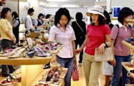 Women shop at a shoe store in Tokyo. Japan has said it would suspend 5.0 trillion yen ($63 billion) in spending as a political row has left the government facing a severe cash crunch that could see it run out of money within months