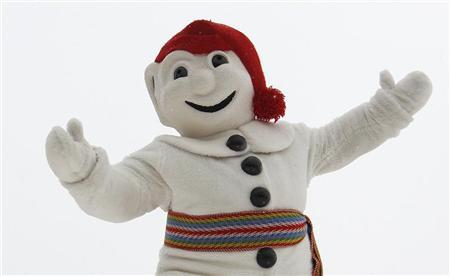 Bonhomme Carnaval, the mascot of the Quebec Winter Carnival, waves to the crowd before the snow bath in Quebec City