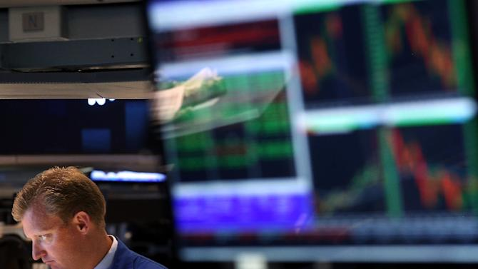 Traders work on the floor of the New York Stock Exchange on August 13, 2014 in New York City