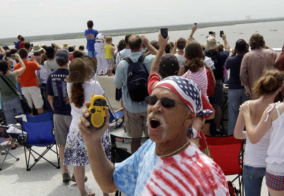 Doug Chambers reacts as the countdown reaches 10 seconds to liftoff for space shuttle Atlantis Friday, July 8, 2011, in Titusville, Fla. Four astronauts are taking space shuttle Atlantis for one last ride, the very last one of the 30-year space shuttle era. (AP Photo/David J. Phillip)