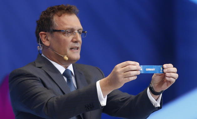 FIFA Secretary General Jerome Valcke holds the ticket of Germany during the draw ceremony for the 2014 soccer World Cup in Costa do Sauipe near Salvador, Brazil, Friday, Dec. 6, 2013