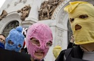 "Supporters of punk group ""Pussy Riot"" wear the band's trademark coloured balaclavas during a protest outside the Church of Christ the Saviour in central Moscow. Russian police arrested four activists during the demonstration"