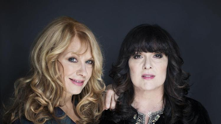 This Oct. 1, 2012 file photo shows sisters Nancy, left, and Ann Wilson from Heart in New York. The Wilson sisters will be inducted into the Rock and Roll Hall of Fame at a ceremony held in Los Angeles on April 18, 2013. (Photo by Victoria Will/Invision/AP)