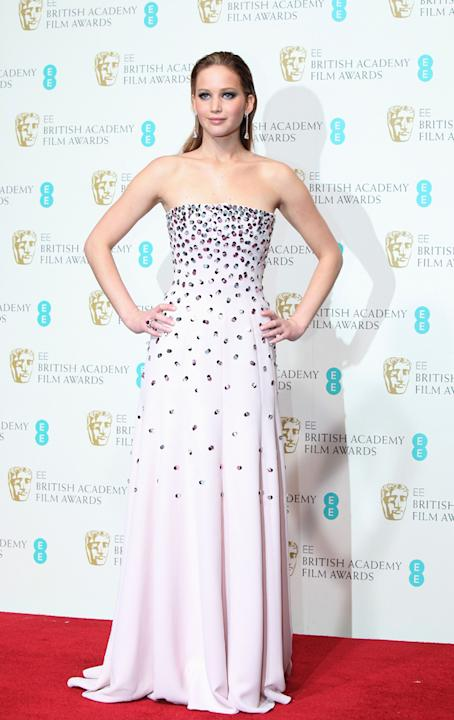 After walking down the red carpet in a large over coat, Jennfier unveiled her beautiful dress at the 2013 BAFTA awards to the press. Copyright [Rex]