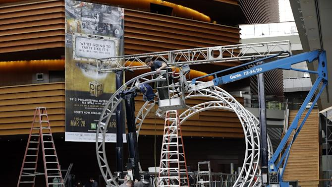 Workmen begin Preparations for the Philadelphia International Festival of the Arts 2013, at the Kimmel Center Tuesday, Feb. 19, 2013, in Philadelphia.  The citywide festival is scheduled to run from March 28 to April 27. (AP Photo/Matt Rourke)
