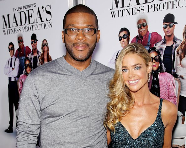 "This June 25, 2012 photo released by Starpix shows actors Tyler Perry, left, and Denise Richards, at the premiere of the Lionsgate film, ""Tyler Perry's: Madea's Witness Protection,"" at the AMC Lincoln Square Theater in New York. The film, starring Perry, Richards, Romeo, and Eugene Levy, opens nationwide on June 29. (AP Photo/Starpix, Marion Curtis)"