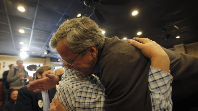 U.S. Republican presidential candidate Jeb Bush shares a hug with James Berry after speaking with him during a campaign event in Florence