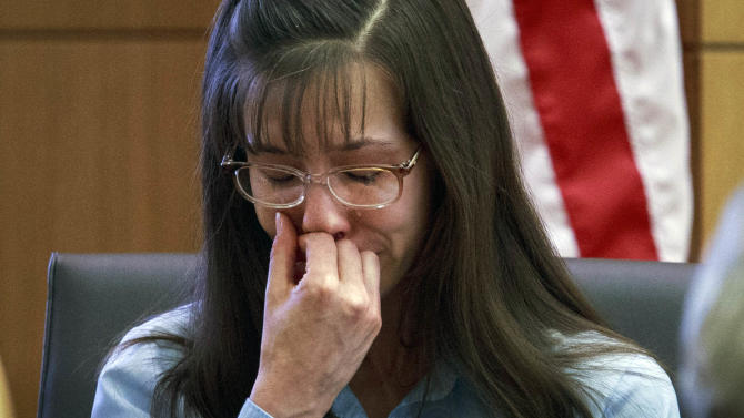 Defendant Jodi Arias loses her composure as she testifies about killing Travis Alexander in 2008 during her murder trial at Judge Sherry Stephens'   Maricopa County Superior Court  in Phoenix on Wednesday, Feb. 20, 2013.   Arias is charged in the 2008 stabbing and shooting death of her lover, Alexander.  She faces the death penalty if convicted of first-degree murder.  (AP Photo/The Arizona Republic, Charlie Leight, Pool)