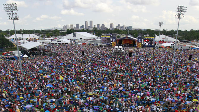 FILE - This May 5, 2012 file photo shows crowds at the New Orleans Jazz and Heritage Festival in New Orleans. Despite heat, humidity, crowds and costs, music festivals are more popular than ever, attracting millions of fans, with 270 festivals of various types annually in the U.S. and more than 800 in 57 countries. (AP Photo/Gerald Herbert, file)