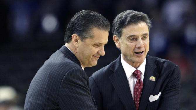 FILE - in this March 31, 2012, file photo,  Louisville head coach Rick Pitino, right, shakes hands with Kentucky head coach John Calipari before the first half of an NCAA Final Four semifinal college basketball tournament game in New Orleans. Kentucky has fallen out of the Top 25 and the defending national champs are still looking to establish themselves heading into the instate showdown with rival Louisville. The fourth-ranked Cardinals Saturday will try to end a four-game skid against the Wildcats. (AP Photo/David J. Phillip, File)
