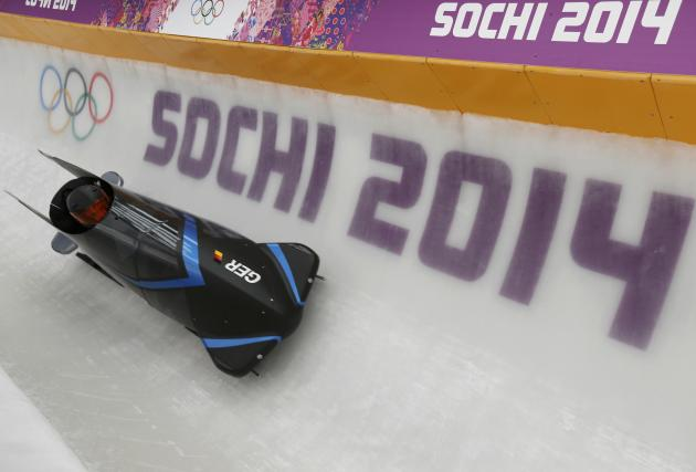 Germany's two-men bobsleigh pilot Arndt speeds down the track during an unofficial men bobsleigh progressive training at the Sanki sliding center in Rosa Khutor, a venue for the Sochi 2014 Winter