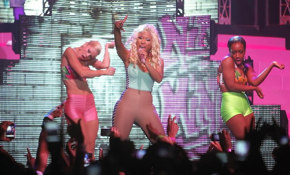 Nicki Minaj, Trinidadian-born American rapper, singer, songwriter and voice actress, performs at Roseland Ballroom on Tuesday, Aug. 14, 2012 in New York. (Photo by Jason DeCrow/Invision/AP)