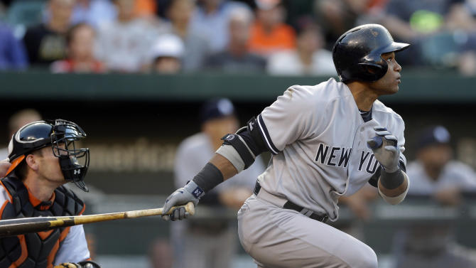 New York Yankees' Robinson Cano watches his solo home run in the first inning of a baseball game against the Baltimore Orioles in Baltimore, Monday, May 20, 2013. (AP Photo/Patrick Semansky)
