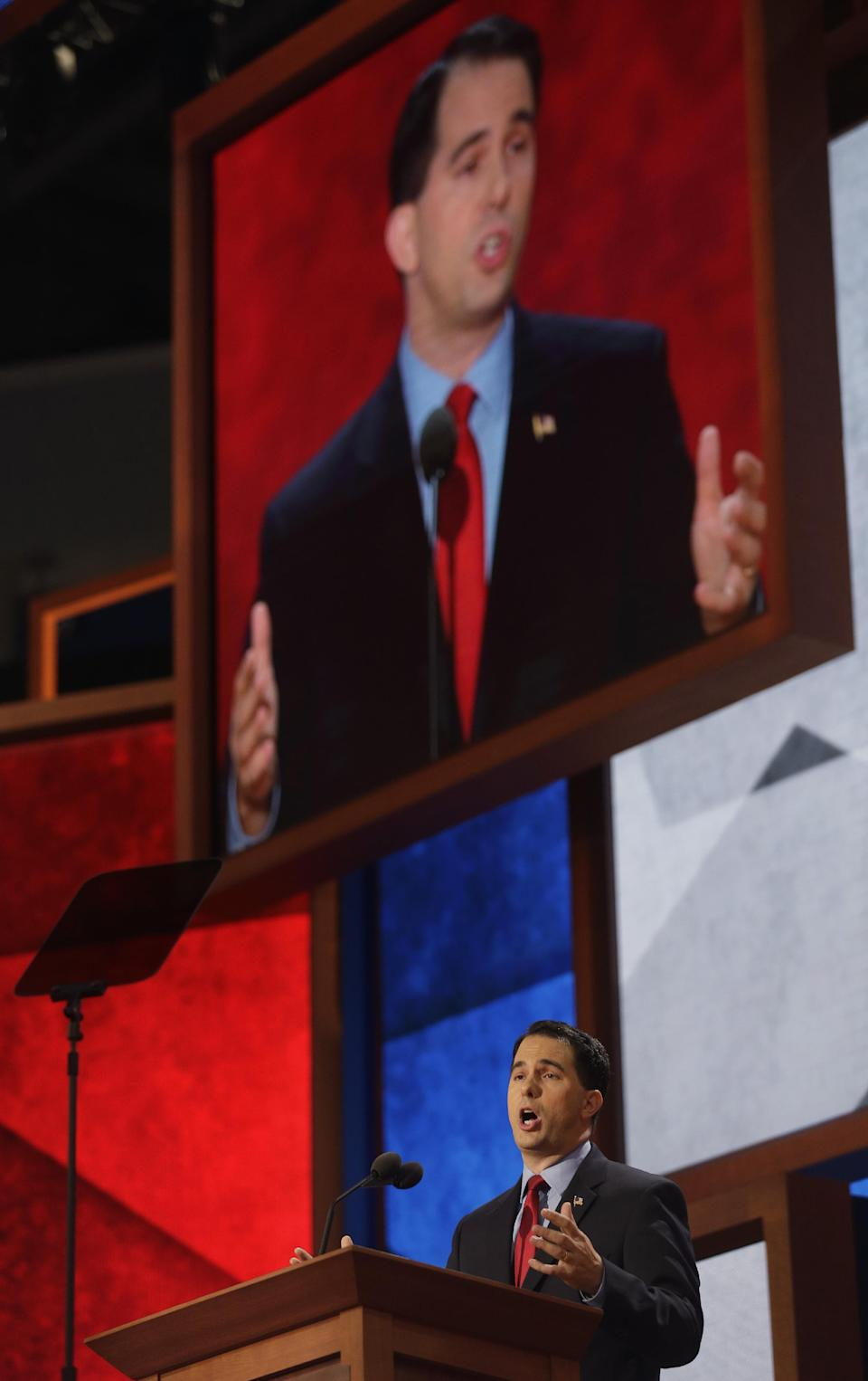 Wisconsin Gov. Scott Walker addresses Republican National Convention in Tampa, Fla., on Tuesday, Aug. 28, 2012.(AP Photo/Charles Dharapak)