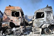Carcasses of burnt-out lorries at the Bab al-Hawa border post with Turkey after it was seized by Syrian rebels following fierce battle with Syrian troops in Bab al-Hawa on July 20. Dozens of Turkish truck drivers on Saturday accused rebel fighters of the Free Syrian Army of having burned and looted their lorries as they stormed a border post in Syria