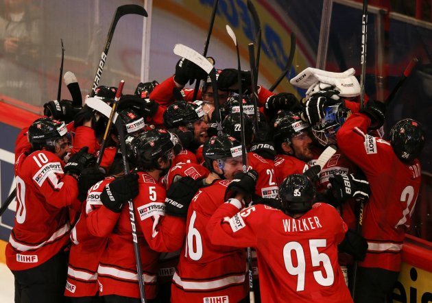 Switzerland's players celebrate victory against the U.S. in their 2013 IIHF Ice Hockey World Championship semi-final match at the Globe Arena in Stockholm