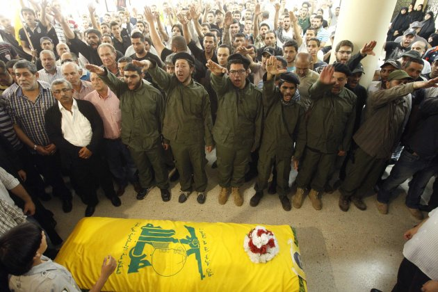 Supporters of Hezbollah and relatives of Saleh Ahmed Sabagh, a Hezbollah member, gesture during his funeral in the port-city of Sidon