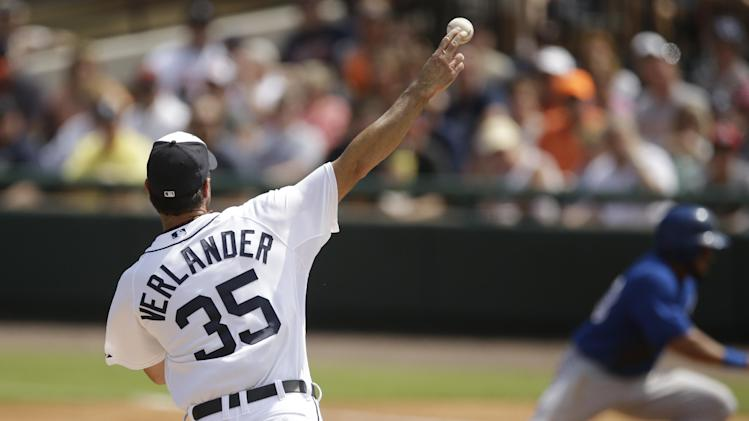 Detroit Tigers starting pitcher Justin Verlander (35) throws back to first trying to pick off a Toronto Blue Jays runner during a spring exhibition baseball game in Lakeland, Fla., Tuesday, March 11, 2014. (AP Photo/Carlos Osorio)