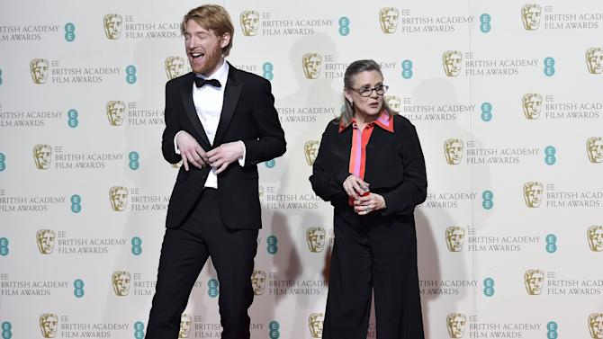 Carrie Fisher and Domhnall Gleeson pose after presenting the award for Best film not in the English language at the British Academy of Film and Television Arts (BAFTA) Awards at the Royal Opera House in London