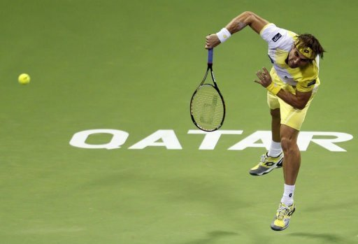 Spain's David Ferrer returns the ball to Germany's Dustin Brown during the 2013 ATP Qatar Open in Doha on January 1, 2013. Ferrer won 5-7, 6-3, 6-2