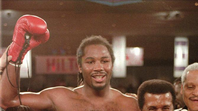 File-This Feb. 7, 1997 file photo shows newly crowned WBC heavyweight champion Lennox Lewis, center, reacting with his mother, left, and trainer Emanuel Steward after defeating Oliver McCall with a TKO in the fifth round at the Hilton Hotel in Las Vegas. teward, the owner of the legendary Kronk Gym and one of boxing's greatest trainers, has died. He was 68. Victoria Kirton, Steward's executive assistant, says Steward died Thursday Oct. 25, 2012 in a Chicago hospital. She did not disclose the cause of death.  (AP Photo/Jeff Scheid, File)
