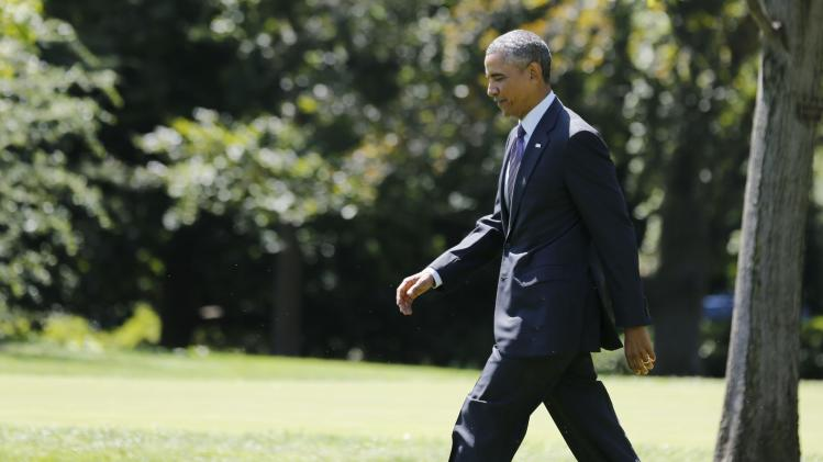 U.S. President Obama walks on the South Lawn towards Marine One at the White House in Washington