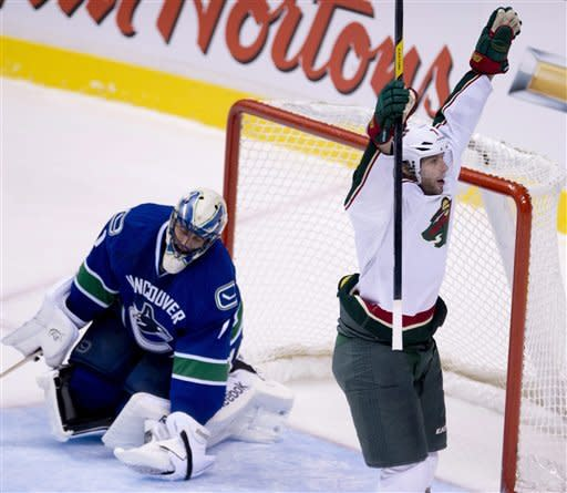 Coyle and Backstrom lead Wild over Canucks 3-1