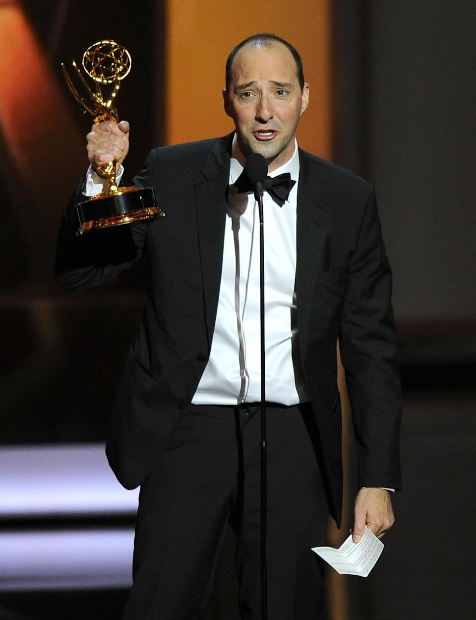 "Tony Hale accepts the award for outstanding supporting actor in a comedy series for his role on ""Veep"" at the 65th Primetime Emmy Awards at Nokia Theatre on Sunday Sept. 22, 2013, in Los Angeles. (Photo by Chris Pizzello/Invision/AP)"