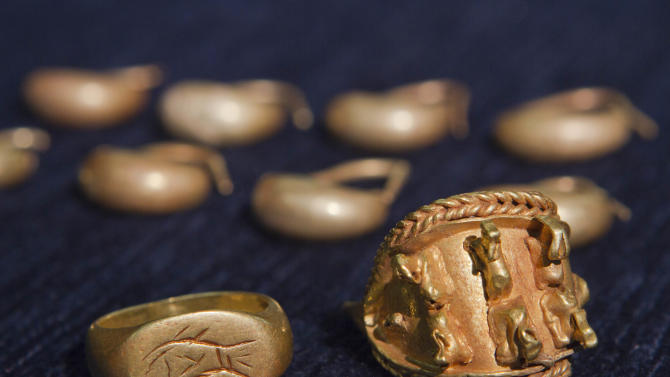 In this photo taken Wednesday, May 23, 2012, ancient jewelry discovered by Israeli archaeologists is displayed at  the Tel Aviv University, Israel. Israeli archaeologists have unearthed a stash of rare ancient jewelry near the site of the biblical Armageddon in the north of the country. Israel Finkelstein of Tel Aviv University, who co-directed the dig, said this week that the find offers a rare glimpse into ancient Canaanite high society. The 3,000-year-old jewelry was found inside a ceramic vessel, suggesting the owner hid them before fleeing, he said. (AP Photo/Dan Balilty)