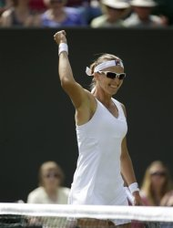 Yaroslava Shvedova of Kazakhstan reacts after defeating Sara Errani of Italy during a third round women's singles match at the All England Lawn Tennis Championships at Wimbledon, England, Saturday, June 30, 2012. (AP Photo/Sang Tan)