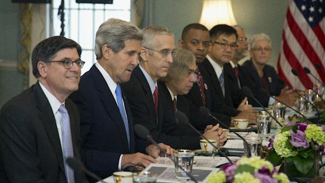 Treasury Secretary Jacob Lew, left, Secretary of State John Kerry, second from left, and others, participate in the Joint Session on Climate Change with Chinese delegation headed by Chinese Vice Premier Wang Yang, and China's State Councilor Yang Jiechi, Wednesday, July 10, 2013, in the Thomas Jefferson Room at the State Department in Washington. (AP Photo/Manuel Balce Ceneta)