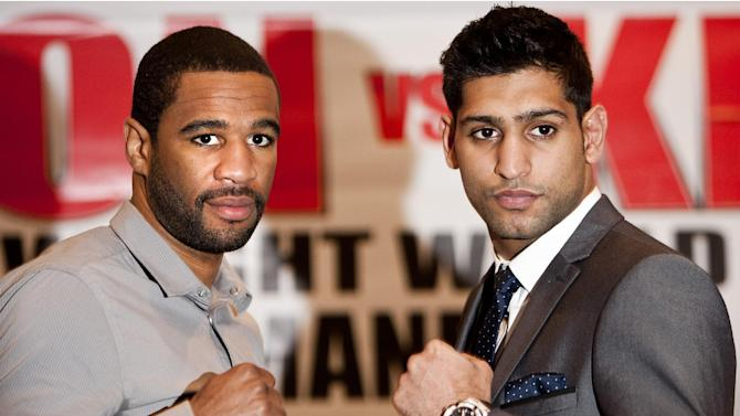 FILE - This March 13, 2012 file photo shows  WBA and IBF light welterweight champion Lamont Peterson, left, of the United States, and British Boxer Amir Khan, posing following a news conference in London. A Nevada regulator says Peterson failed a drug test, and a May 19 rematch in Las Vegas against former title holder Khan is in doubt. (AP Photo/Brynjar Gauti, FIle)