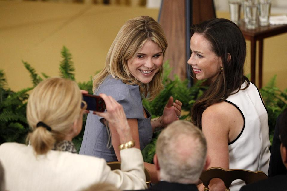 President George W. Bush's daughters Jenna and Barbara have their photo taken in the East Room at the White House in Washington Thursday, May 31, 2012, prior to the unveiling of President Bush's official portrait. (AP Photo/Charles Dharapak)