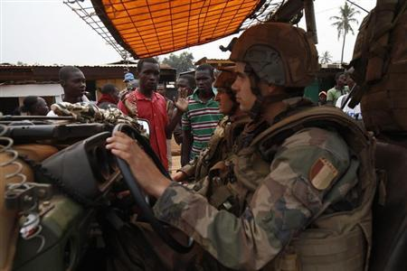 Angry young men complain to French soldiers on patrol in the pro-Christian area of Bangui
