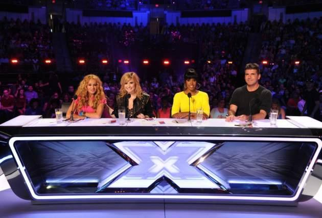 The judges' panel for 'The X Factor' Season 3 -- Paulina Rubio, Demi Lovato, Kelly Rowland and Simon Cowell -- FOX