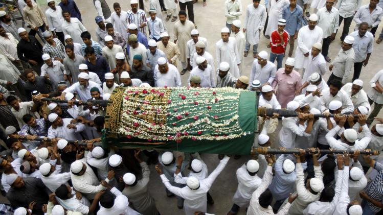Relatives and others carry the coffin of Aijaz Ahmed, killed in Thursday's explosion, during his funeral in Hyderabad, India, Friday, Feb. 22, 2013. Indian police are investigating whether a shadowy Islamic militant group was responsible for a dual bomb attack that killed over a dozen people outside a movie theater and a bus station in the southern city of Hyderabad, a police official said Friday. (AP Photo/Aijaz Rahi)