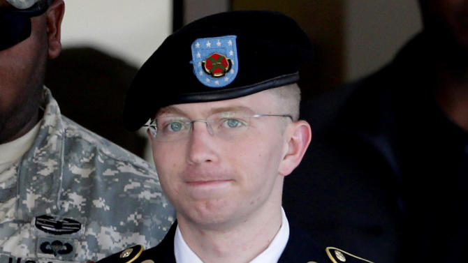 FILE - In this June 25, 2012 file photo, Army Pfc. Bradley Manning, right, is escorted out of a courthouse in Fort Meade, Md.  Manning is charged with aiding the enemy by causing hundreds of thousands of classified documents to be published on the secret-sharing website WikiLeaks. (AP Photo/Patrick Semansky, File)