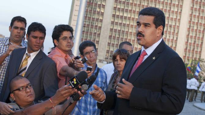 ADDS COMPLETED SECOND SENTENCE-Venezuela's President Nicolas Maduro, right, talks with reporters after a wreath-laying ceremony at the Jose Marti monument in Havana, Cuba, Saturday, April 27, 2013. Maduro is in Cuba to sign agreements with the government of Raul Castro. (AP Photo/Ramon Espinosa)