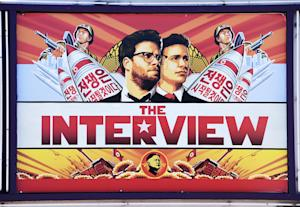 """A poster for """"The Interview"""" displayed at…"""