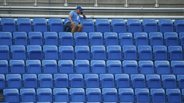 A lone fan watches the fourth round match between Dimitrov of Bulgaria and Monfils of France at the 2014 U.S. Open tennis tournament in New York