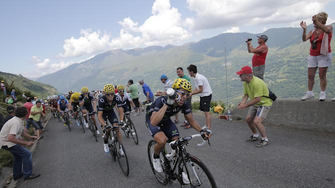 Jonathan Castroviejo of Spain leads before teammate Spain's Alejandro Valverde as they climb Hourquette d'Ancizan pass during the ninth stage of the Tour de France cycling race over 168.5 kilometers (105.3 miles) with start in Saint-Girons and finish in Bagneres-de-Bigorre, Pyrenees region, France, Sunday July 7 2013. (AP Photo/Christophe Ena)