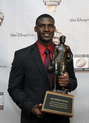 LSU's Morris Claiborne holds the Jim Thorpe Award given to the nation's most outstanding defensive back during the College Football Awards show in Lake Buena Vista, Fla., Thursday, Dec. 8, 2011. (AP Photo/Phelan M. Ebenhack)