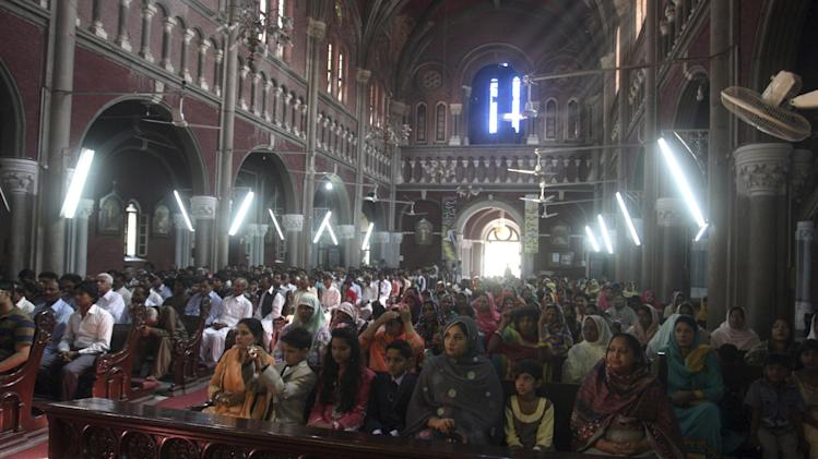 Christians attend Easter Mass at Sacred Heart Cathedral in Lahore, Pakistan, Sunday, April 20, 2014. Millions of Christians around the world celebrated Easter commemorating the day when according to Christian tradition Jesus was resurrected in Jerusalem two millennia ago. (AP Photo/K.M. Chaudary)