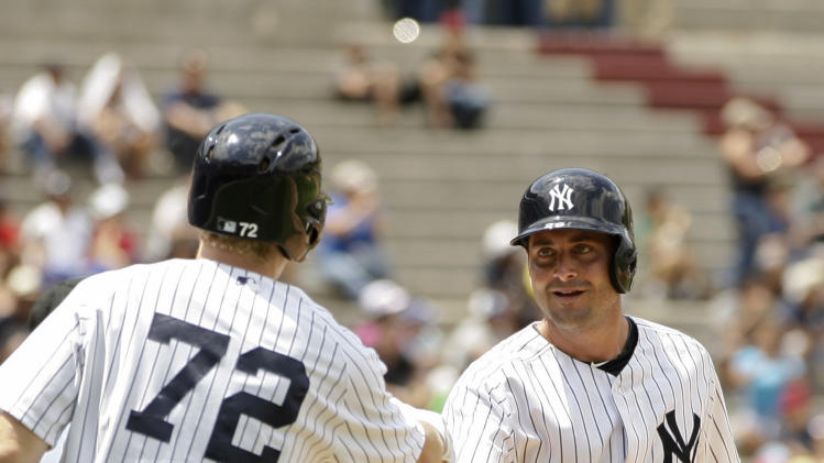 New York Yankees Francisco Cervelli, right, celebrates a run against the Miami Marlins with teammate Corban Joseph during the second inning of their Legend Series exhibition baseball game in honor of Mariano Rivera in Panama City, Sunday, March 16, 2014