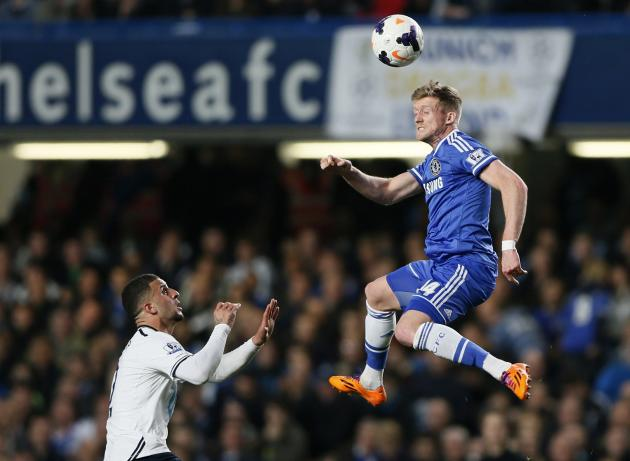 Chelsea's Schurrle is challenged by Tottenham Hotspur's Walker during their English Premier League soccer match at Stamford Bridge in London