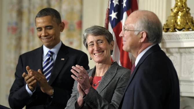 President Barack Obama and his Interior Secretary nominee, REI Chief Executive Officer Sally Jewell, center, applaud outgoing Interior Secretary Ken Salazar , Wednesday, Feb. 6, 2013, in the State Dining Room of the White House in Washington where the president made the annoncement. (AP Photo/Susan Walsh)