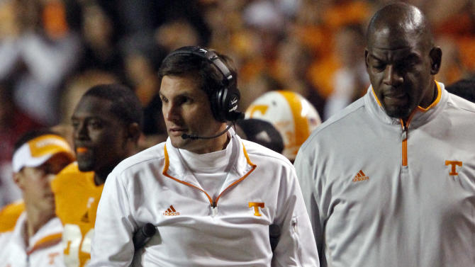Tennessee head coach Derek Dooley walks the sideline on crutches during the second quarter of an NCAA college football game against Alabama, Saturday, Oct. 20, 2012 in Knoxville, Tenn. (AP Photo/Wade Payne)