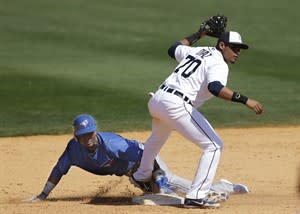 Toronto Blue Jays' Eugenio Velez and Detroit Tigers second baseman Argenis Diaz look for the call after Velez was tagged out on a steal attempt in the eighth inning of a spring training baseball game, Friday, March 15, 2013, in Lakeland, Fla. (AP Photo/Carlos Osorio)