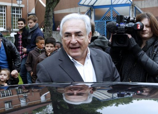 <p>File photo of Dominique Strauss-Kahn in Sarcelles, a Paris suburb. A French court will Wednesday rule on whether to drop pimping charges against former IMF chief Dominique Strauss-Kahn in the last sex crime case against him in France.</p>
